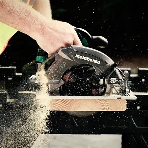 Metabo HPT Cordless Power tool cutting through a wood plank