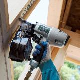 Siding nailer in action